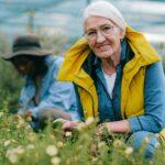 Older woman kneeling in garden